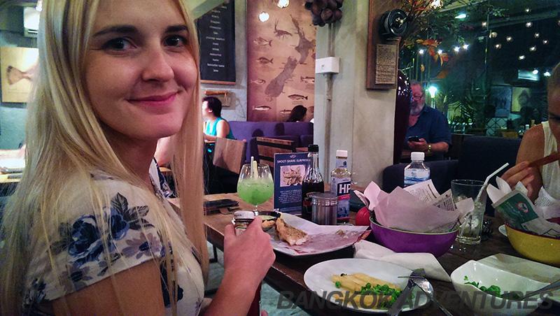 Happy customer eating at Snapper's in Bangkok