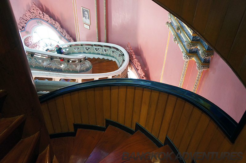 Wooden spiral staircase at Erawan Museum